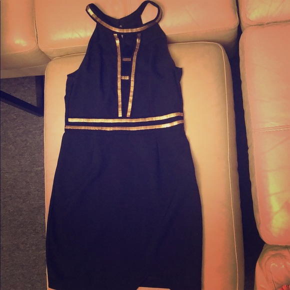 Sexy little black dress with gold accent.